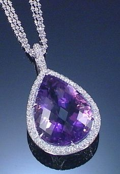 AMETHYST AND DIAMOND PENDANT NECKLACE Centring on a facetted pear-shaped amethyst to a mount set throughout with brilliant-cut diamonds, on a necklace composed of three fancy link chains, length approximately 390mm.
