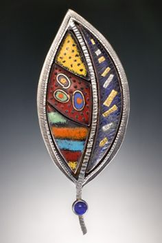 Susan Buckley creates her jewelry from sterling and fine silver, various different karats of gold, precious and semi-precious stones, and torch-fired vitreous enamels.