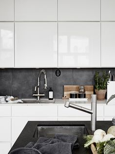 Now that's a beautiful kitchen. White, a dark slate, and stainless. Maybe make…