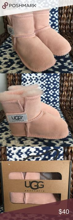 "UGG Baby 'I Erin' Baby Pink Boots (12-18 Months) Model: 5202 Perfect for the tiniest trendsetters, the Erin is crafted from soft suede and lined with plush sheepskin. This takedown of our iconic silhouette features a simple lateral hook-and-loop closure to take some of the fuss out of getting dressed.  DETAILS:  Suede Sheepskin lining Hook-and-loop closure UGGpure™ wool insole Suede outsole Approx. 3 ¼"" shaft height UGG Shoes Baby & Walker"