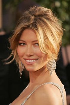 Capture the classic sexy librarian look like Jessica Biel. Backcomb the crown just a touch, pull hair back into a twist, and let long bangs drape wantonly.