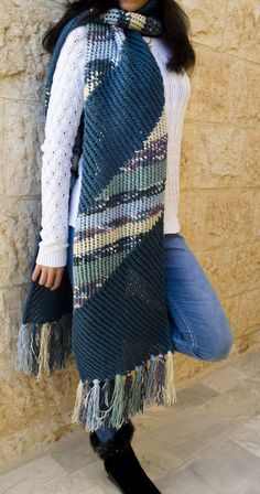 "Free Knitting Pattern for Diagonal Stripe Super Scarf - This Cozy Scarf features alternating sections of 6 row repeat diagonal stitch in solid yarn with sections in self-striping or variegated yarn. Matching hat pattern included. 13"" x 90""(227 cm x 33 cm). Worsted weight yarn. Designed by Wiam's Crafts"
