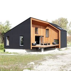 A decked terrace bites into the side of the building, revealing the cross-laminated timber structure behind the rubber cladding. Black Exterior, Exterior Design, Style At Home, Residential Architecture, Interior Architecture, Timber Structure, Prefab Homes, Home Fashion, Bungalow