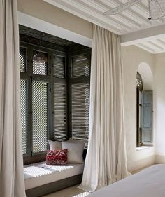A Moroccan riad, complete with traditional wood lattice work in the windows. Renovation by Romain Michel-Meniere.
