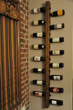 small spaces wine rack to make. Cute for wall decoration... god knows we go through enough wine: