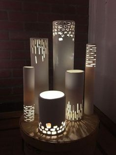 DIY PVC pipe lighting tutorial - gorgeous!  Would be pretty spray painted or covered in vinyl, etc.