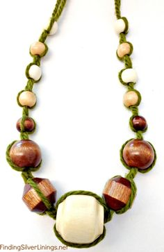 necklace...maybe try with leather instead of yarn...or maybe a thin ribbon...