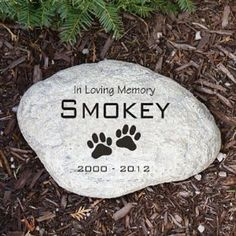 """Pet Memorial Stone Engraved   This Engraved Memorial Garden Stone is made of durable resin and has a real stone look. It is lightweight and waterproof.  The words """"In Loving Memory"""" and the paw prints are part of the stone.  You provide your pet's name (will show as all capitals) and years. 5.5"""" wide x 4.25"""" high x 1.25"""" deep Ships out in 1 to 2 days Item: PG714S Price: $15.25 Larger engraved stone is 11"""" wide x 8"""" high x 1.25"""" deep and sells for $28.95"""