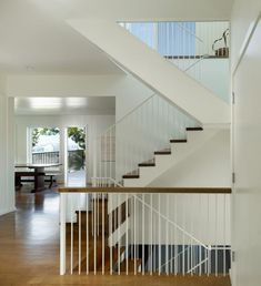 The stairs are recognizably old-fashioned in shape, but the railing has been reinterpreted with modern steel spindles.