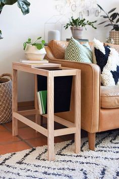 Learn how to build a gorgeous Modern Book Sling Side table for your home. When you can't find the perfect side table, just DIY one yourself. Delineate Your Dwelling