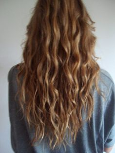 mermaid hair: long in the back with layers starting at underarm length, then layered face framing bangs