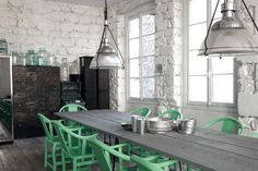 Grey painted wooden table, mint-green metal chairs. Designer: Paola Navone