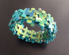 Wonder if this suits your fancy?  jigsaw puzzle bracelet by hotchkissco on Etsy