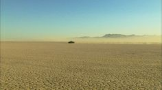 Custom Car, El Mirage Lake, Customizing, Mojave Desert, Car Racing, Dusting (Dust), Race (Sports), Motor Racing, Motor Sports, Sports Event, California, Blue Sky, Southwest, Driving (Procedure), Non Urban Scene, Mountain Region, Mountains, USA, North America, Moving (Motion), Sunshine, People, Day, Stock Footage,