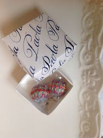Earrings and calligraphic box