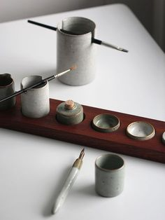 Watercolor palette set with hand-thrown pieces and a pen and brush holder. An assortment of crackle glazes and gold lustre. © Florian Gadsby - See more at: http://theartofplating.com/news/florian-gadsby-searching-for-functionality/#sthash.SLFWKBVs.dpuf