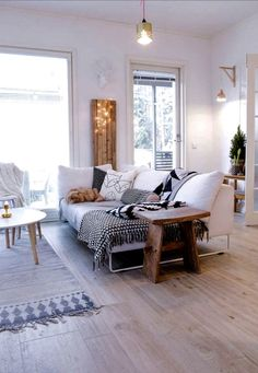 Huge couch, all white room with neutral accents.