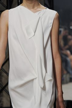 Simple lines with fold & drape detail to create interest - closeup fashion; dress details // Maison Rabih Kayrouz