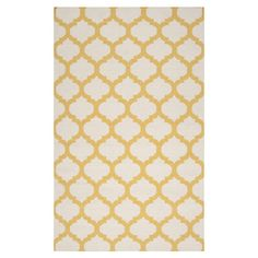 Handmade flatweave wool rug with a yellow quatrefoil motif.  Product: RugConstruction Material: Wool...