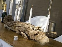 Make a candle holder from an old tree trunk and create a beautiful centerpiece. http://www.songbirdblog.com