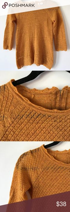 Anthropologie Moth Sweater Anthropologie Moth sweater Zipper detailing in the back Mustard yellow/rust color Bust (pit to pit) 18 in Length - 24 in Size SP  I do my best with measurements, but I can't guarantee them to be 100% accurate :)  ****Feel free to ask me any questions! I offer 10% off of bundles of 2 or more! Also, I'm open to reasonable offers :)*** - I don't do trades or try on's R Anthropologie Sweaters