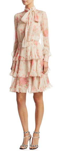 """silk chiffon rose dress by Valentino. Ruffle trimmed silk chiffon dress in artful rose print. Tie neck. Long sleeves. Concealed back zip. About 44"""" from shoulder to hem. Silk. Dry clean. Made in Italy. Model shown is 5'10"""" (177cm) wearing US size 4. #valentino #dresses"""