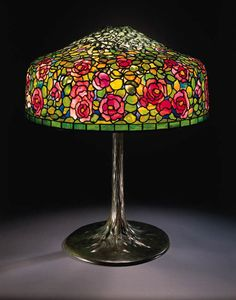 A FINE 'ROSEBUSH' LEADED GLASS AND BRONZE TABLE LAMP   Tiffany Studios   29in. (79.5cm.) high, 25in. (63.5cm.) diameter of the shade   the shade tag stamped TIFFANY STUDIOS NEW YORK, the 'tree-trunk' base stamped TIFFANY STUDIOS NEW YORK 553