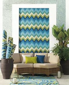 With a lively, dimensional interpretation of the classic flame stitch pattern in cool blues and greens, the Vera Flame outdoor area rug is haute couture for your outdoor -- or indoor -- floor.