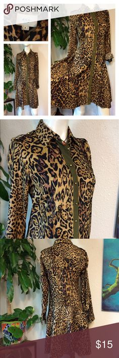 "eci Animal Print Shirt Dress Leopard Button Down ❤️Perfect little shirt dress for travel, office, or errands. By eci New York in size 4  Buttons all the way down- sleeves can be worn long or 3/4 buttoned- small unraveling at left armpit but not torn  ❤️Fabric Content: 95% Poly 5% Spandex ❤️Lined: No  ❤️Approx measurements laid flat- (double where necessary)  Shoulder to shoulder: 15.5"" Underarm to underarm: 18"" Waist: 17"" Hips: 20"" Shoulder to hem: 37"" Sleeve: 23"" un-cuffed ECI Dresses Midi"