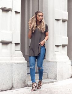 Long loose shirt with light washed jeans.