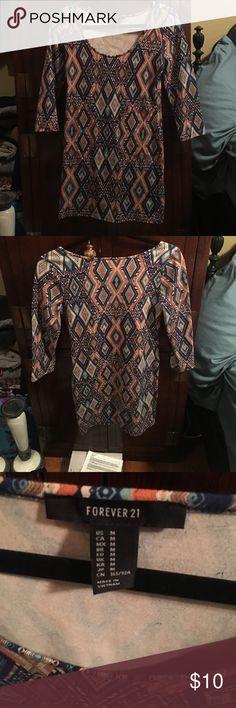 Forever 21, bodycon, tribal print, mini dress Forever 21, tribal print, bodycon, mini dress! Worn once, beautiful jewel tones and pattern Forever 21 Dresses Mini