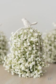 If you head to a craft store, you may find yourself eyeing rows of decorative bird cages. Using these cages as part of your centerpieces is an awesome idea, especially for a vintage or garden wedding reception. Just put some flowers around it (or in it!) and you have a super pretty look for your guest tables.