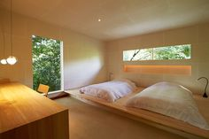 Bed platform. Note the recessed niche by the headboard for books and decor.