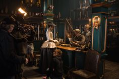 Here is a new BTS still of Caitriona Balfe and Dominique Pinon Source
