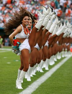 Cheerleaders Kicking high