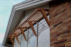 Mid-Century Awning --Sleek design provides sun break and interest for 50s ranch --Unique tapered supports highlight original style --Project includes matching trellis above garage door