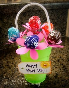 Cute May Day Basket ~ One of the most popularly known May Day traditions is to hang a basket full of spring flowers and/or other small gifts on a neighbor's doorknob. The trick is you don't want the neighbor to see you! If you get caught, you are supposed to get a kiss.