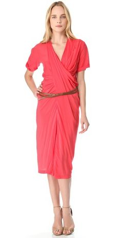 388.50  Donna Karan cuts a cool, casual dress from vibrant stretch georgette, which cascades in layers of gentle folds through the bodice and midi skirt for a modern look