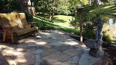 Lakeside flagstone patio with polymer grout and statuary and bench.