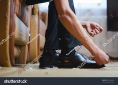 Men putting his black shoes. Hands of men getting ready in suit. Wedding day