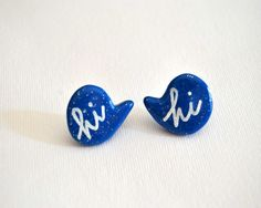 Handmade sparkling blue polymer clay earrings with the handpainted writing Hi created by me in a no smoking room in Verona, Italy.  I create the