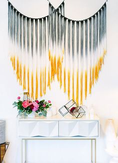 Macramé wall hanging dip dyed to match wedding décor. Credit: greenweddingshoes.com #macramé #wallhanging #weddingdecor