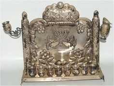 ANTIQUE STERLING SILVER FOOTED MENORAH EMBOSSED LIONS OLD JUDAICA