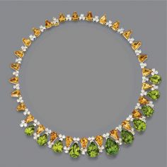 Peridot, citrine quartz and diamond necklace  Designed as a fringe of pear-shaped peridots graduating in size, supported by a row of calf's-head-cut citrines alternating with trios of round rose-cut diamonds, the total diamond weight approximately 15.90 carats, mounted in 18 karat gold, length 16½ inches.