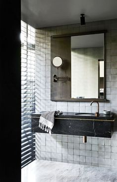 The stunning bathrooms caught my eye in this converted factory apartment, designed by Fiona Lynch. The combination of textures, tones, materials and lighting come together beautifully in both bathroom