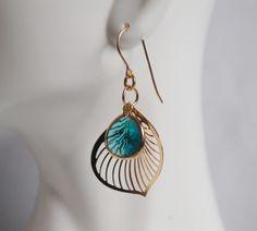 Leaf Charm and bezel setting Paraiba  blue Earrings. $32.00, via Etsy.