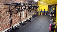 Wall functional training station with dual tiered pull up bar sections, suspension training, battle rope, resistance bands anchors. I deal for small fitness studio and personal training Trx Gym, Gym Workouts, Personal Training Studio, Personal Trainer, Gym Interior, Suspension Training, Gym Decor, Gym Room, Boutique Homes