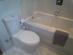 new shower (where old sink & toilet were)