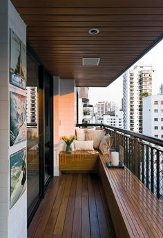Contemporary Loft Finds The Perfect Balance Between Cool And Elegant The loft has a very cool balcony. It's small but very inviting and beautiful. The designer used Cumaru wood for the balcony seats and floor and he also designed the roof to match them.  Overall, the loft is very beautifully balanced. The combination of cement, distressed leather, natural linen, rich wood and the perfect wall décor makes this space a dream home.