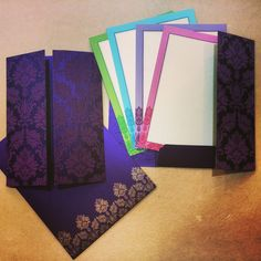 This card is made out of purple shimmery card board. Front is covered with embossed floral imprint. Open like door at both sides and beautiful ribbon used to tie the card close. Card have option of three different color bordered inserts inside and matching mailing envelope. #Interfaith #WeddingCards